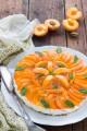 Cheesecake alle albicocche con base ai cereali senza colla di pesce